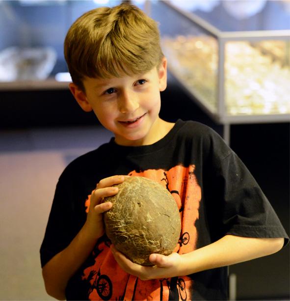 Child with dinosaur egg